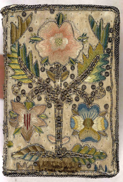 clmommsen:  17th century embroidered satin book with floral motif. by Aria Nadii on Flickr.