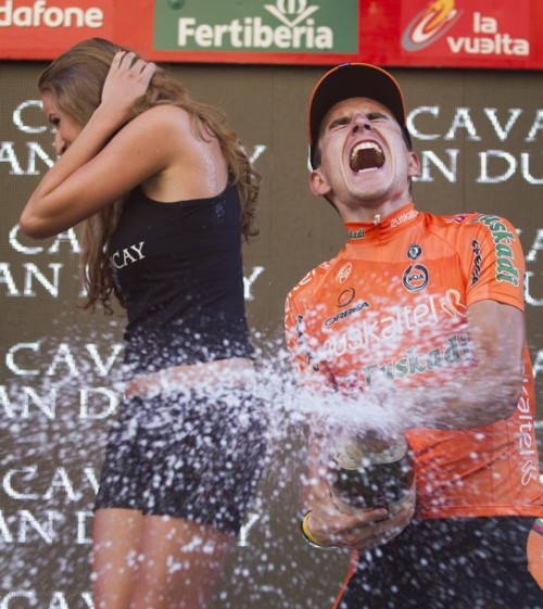 weheartcycling:  Igor Anton celebrates on the podium after winning the 19th stage of the Vuelta.  I can't tell if he's angry or excited. All I know is that a face of releasing emotion…