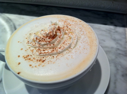 Come enjoy a cup of warm Chai Latte as it's getting cold out. Made with real brewed black tea and chai spices with foamy steamed milk, finish with whipped cream and a dash of ground cinnamon. Yum!