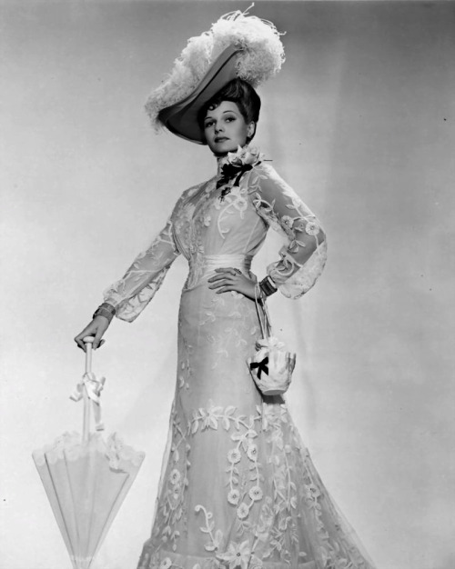 Publicity still of Rita Hayworth dressed in 1890s costume for The Strawberry Blonde (1941) Gowns by Orry-Kelly Image Source