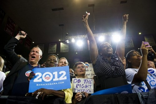 apsies:  People in the audience cheer as President Obama speaks on the American Jobs Act at the University of Richmond in Richmond, Virginia on September 9, 2011.