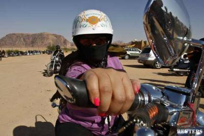 Two moto ladies appear at the Delhi-Leh rally in India. Irina Walker, 49, flew in from San Francisco for the Himalayan Odyssey 2011. Ila Johri, 25, is a financial analyst based in Chennai. Rally participants are expected to ride hilly terrain of Ladakh region in Jammu and Kashmir. Beginning from Delhi the route map of the rally passes through Chandigarh, Manali, Key Long, Jispa Camp, Sarchu, Pang Camp, Upshi, Leh and finally to Khardung La, the highest motorable pass in the Ladakh region.