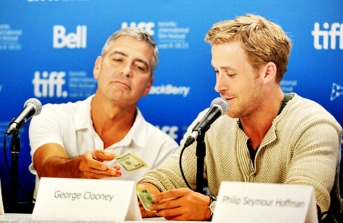 fuckyeahmcgosling:  George Clooney, giving $50 to Ryan Gosling after he said that working with him was 'more than fun. It was life altering… Watching him work was watching a unicorn being born every day.'