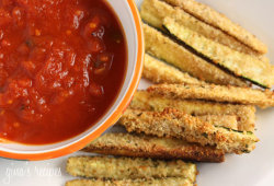 "Baked Zucchini Sticks Gina's Weight Watcher RecipesIngredients:  3 medium zucchini sliced into 3"" x 1/2"" sticks 1 large egg white 1/3 cup seasoned whole wheat bread crumbs 2 tbsp grated Pecorino Romano cheese cooking spray 1/4 tsp garlic powder salt fresh pepper In a small bowl, beat egg whites and season with salt and pepper. In a ziplock bag, place breadcrumbs, garlic powder and cheese and shake well. Spray cookie sheet with cooking spray and set aside. Dip zucchini sticks into eggs then into bread crumb and cheese mixture, a few at a time and shake to coat.  Place the breaded zucchini in a single layer and spray more cooking spray on top.  Bake at 425° for about 20-25 minutes, or until golden brown. Makes three servings, 1 zucchini, 122 Calories each  Fat: 2.4 • Carbs: 21.0 g • Fiber: 6.0 • Protein: 6.7 g"