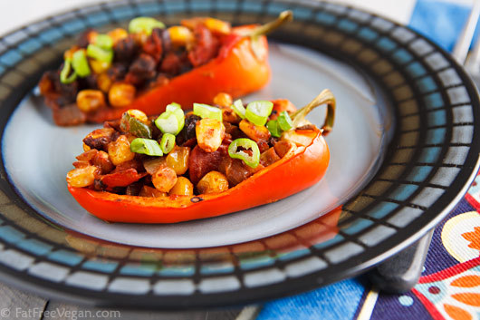 Vegan Chili-Stuffed Peppers  If you don't want to go to the trouble of stuffing peppers, this chili makes a delicious filling for tortillas or pita. Ingredients 1 medium onion, chopped fine 1 large portabello mushroom, diced 1 jalapeño pepper, minced (or more to taste) 1 16-ounce can black beans, drained and rinsed well (or 1 1/2 cups cooked black beans) 1 1/2 cup corn kernels, fresh or frozen 1 15-ounce can can fire-roasted tomatoes 1 teaspoon smoked paprika 1 1/2 teaspoon chili powder* (or more, to taste) 1 teaspoon salt 5 red bell peppers 2 green onions, thinly sliced Instructions Heat a large non-stick skillet or saucepan. Add the onion and cook, stirring often until it softens, about 4 minutes. (Add a splash of water as necessary to prevent sticking.) Add the mushrooms and jalapeno and continue to cook until mushrooms soften. Add black beans, corn, tomatoes, and seasonings. Cook for a few more minutes to allow most of the tomato liquid to cook off. Preheat oven to 400F. While the chili is cooking, prepare the peppers by cutting them in half through the stem end, removing the seeds and membranes, and rinsing the insides to make sure all the seeds are out. Check to see if they will stand upright, and if not, peel a strip off of the back side. Oil a baking dish big enough for the peppers (or line it with parchment paper). Fill each pepper half with the chili and place it in the baking dish. Bake until peppers are tender, about 40 minutes. Sprinkle each pepper with sliced green onions and serve hot. *Note: Penzey's Chili 9000 is used here, a chili powder that contains cumin, oregano, and other spices as well as chiles. Depending on the spiciness and flavor of your chili powder, you may need to add more or less. Five servings of 2 pepper halves each, 190 calories 1.2g total fat, 820.1mg sodium, 38.3g carbohydrates, 11.7g fiber, 9.4g sugar, 10.3g protein