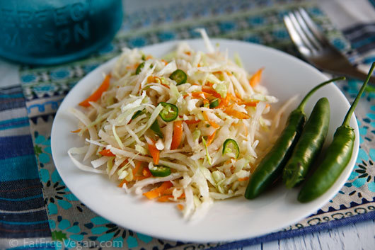 Ridiculously Easy Southwestern Coleslaw  1/2 medium cabbage 2 carrots 1-2 hot chile peppers, thinly sliced or chopped 5-6 tablespoons salsa verde 1 1/2 tablespoons lime juice 2 tablespoons vegan mayo or lite silken tofu 1/2 teaspoon agave nectar (or other sweetener) 1/4 teaspoon cumin salt to taste Instructions Remove and discard the core of the cabbage, and cut cabbage in half. Use a food processor fitted with a shredding disk to shred the cabbage and carrots. Place in a serving bowl along with the sliced chile pepper. Whisk all remaining ingredients together until smooth. (If you're using silken tofu, you may need to blend it in a small blender or food processor.) Add the dressing to the cabbage and mix well. Add salt to taste. Cover and allow to marinate in the refrigerator for at least an hour. Check seasonings before serving and add more salsa, lime juice, cumin, or salt if necessary. Makes six servings, 25 Calories each (using lite silken tofu) 1g total fat, 151.3mg sodium,  5.1g carbohydrates, 1.1g fiber, 2.5g sugar, 1.4g protein,