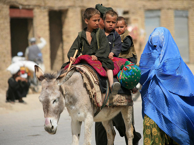 A local Afghan family takes a stroll through the local market ( sad donkey)  :(