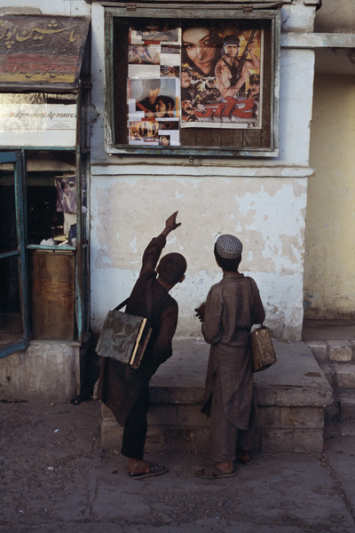 Young men admiring Movie Poster, Pul-i-Khumri, Afghanistan