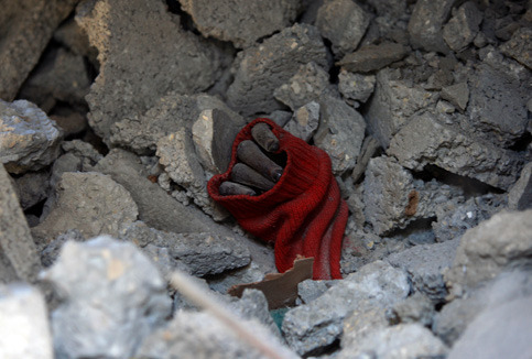 wakeupthedrones:   The hand of a girl from the Samuni family buried under the rubble of her house in the al-Zeitoun neighborhood of Gaza City, 18 January 2009. (Wissam Nassar/MaanImages) ___ And they were likely using weapons provided by American taxpayers to bomb the girl's house.  Sickening.
