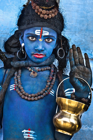 poydflink:  boy dressesd as the hindu god shiva