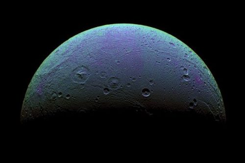 Saturn's icy moon Dione has an atmosphere, albeit a thin one, astronomers have discovered. Image courtesy SSI/NASA