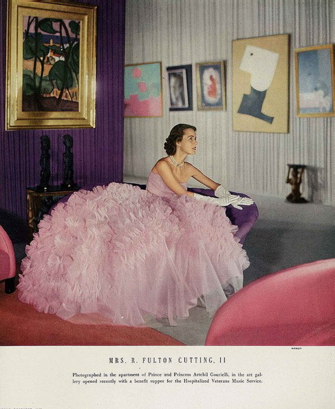 tammy17tummy:  December Vogue 1950 Mrs Cutting is wearing a froth of a ball dress, the skirt is foaming with ruffles, by Ceil Chapman. Clifford Coffin