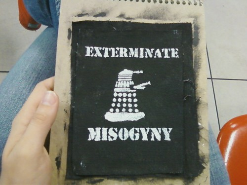 the-doctor-dances:  scyf:  freckledgnome:  Feminist Dalek exterminates misogyny.  oh god susi and marina you must love this stencil  WANT.   NEED.
