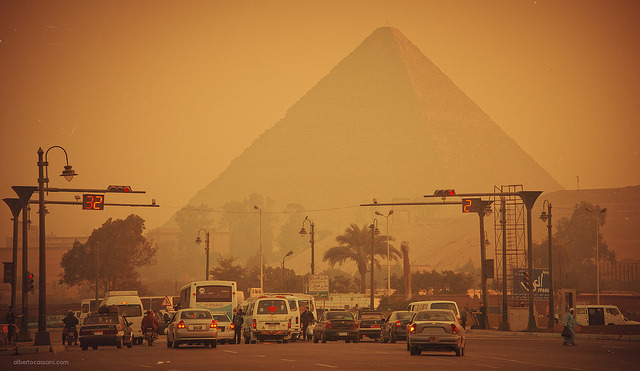 Traffic in Giza with the pyramids in the background, Egypt Photo by Beboflickr