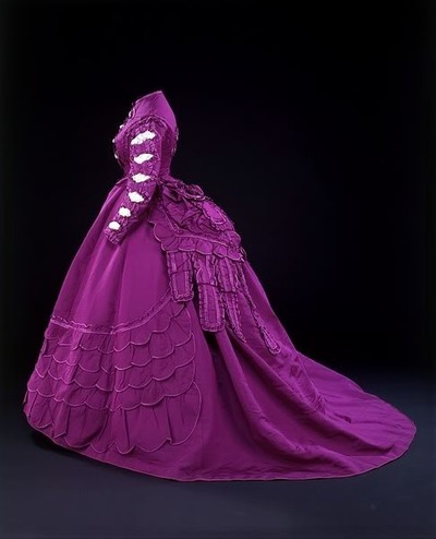 oldrags:  Dress by Mon Vignon, ca 1869-70 France  Many of you have probably seen this dress but I wanted to add an interesting little fact about it that you may not know.  What color would you say the fabric is?  Purple?  Actually, it's mauve as it was meant to look.  The first synthetic dye, mauveine, was discovered by accident in 1856 when an 18-year-old student was trying to find a cure for malaria.  Being the first of its kind, there were problems with the dye that caused the color to fade relatively quickly.  This is why our modern idea of the color mauve is sort of a faded grayish-purple.  Examples that have faded little do exist, though, as seen here.
