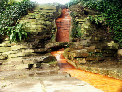 My Bohemian World The iron-rich waterfall at Chalice Well, Glastonbury, England
