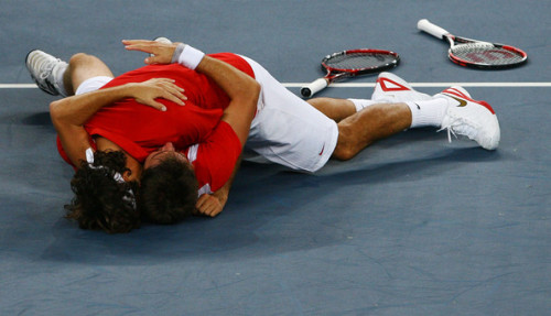 yeahwhateva:  Here's a rugby tackle hug for all the Federer fans who are currently grieving.
