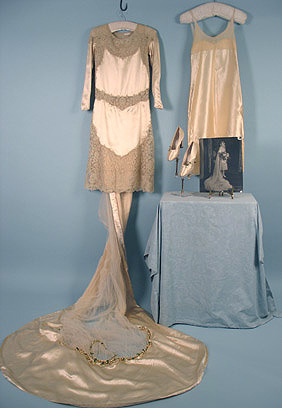 Wedding dress, ca 1926 Wedding dresses were typically short in the 20's but that didn't keep brides from having their long trains.