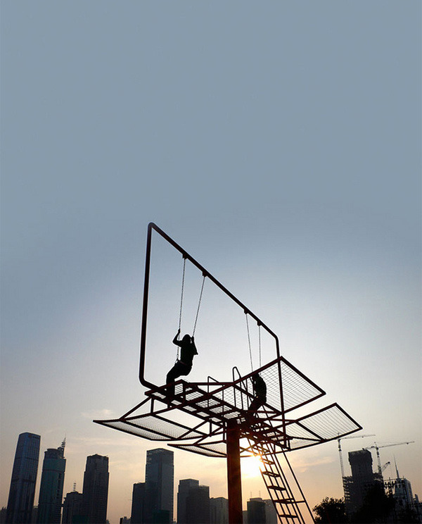A swing inside a billboard. I'd like to have a go.