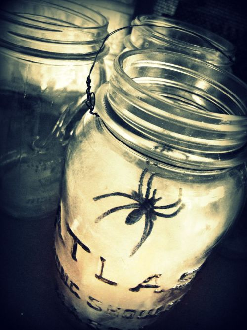 DIY Spiderweb Laterns. Yes, solar and LED mason jar lanterns have been done to death on Tumblr and Pinterest by now. But Halloween Spiderweb Lanterns? I don't think so! Found at The Brass Paperclip Project here.