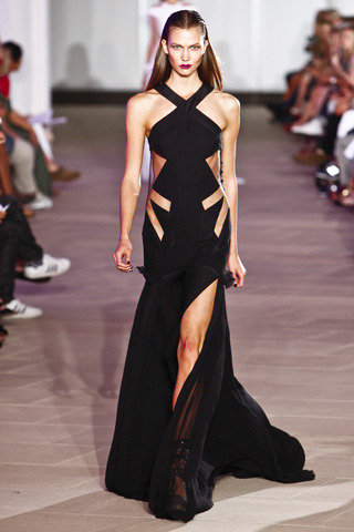 Prabal Gurung Spring RTW 2012 NYC Fashion Week Model: Karlie Kloss  Photo via Style.com  I like the laser cut outs on this halter gown. (And yes, Karlie knows how to work the confident sexy look on the runway.)