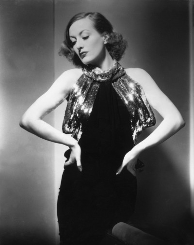 theyroaredvintage:  Joan Crawford smoking hot in a stunning gown. 1940s
