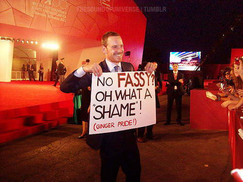 Michael Fassbender with a sign made by fans ( aka me and Giovanna ) at 68th Venice Film Festival.