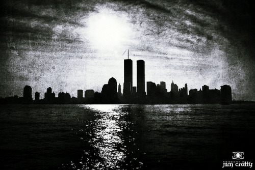 "Sunrise Over Manhattan on August 23 2001 on Flickr. Like it was just yesterday, then again perhaps ages ago. There were particular scenes I experienced 10 years ago that I revisit more than others. The clarity and stillness of the predawn landscape as I was driving from my home in Loveland, Ohio to the Cincinnati Airport in Northern Kemtucky. I had an early flight to LaGuardia and I was running late. I remember looking out over a field to the left, a mile or two before the I-275 bridge over the Ohio River, and noticing this low mist that was sitting in a small depression in the landscape just as light was appearing in the sky. It was a brief moment of a peaceful vision. I thought to myself if I wasn't in such a hurry to catch this flight - which was a trip for my employer at that time - I would find a spot to pull over, break-out the camera and tripod and capture the sun rising over this beuatiful, rural landscape blessed in the light and cool air of morning in early September. I can still see that moment and what I was thinking during the seconds it appeared to me. I managed to get to the gate in time just as my flight was boarding. The group of corporate staff I was traveling with were already seated on the plane. I felt a bit embarrassed because I'm rarely late when it comes to work responsibilities. The plane took off and we were on our way through a clear and smooth sky to New York. Just two and half weeks prior I was in lower Manhattan photographing building interiors and exteriors for my employer, a company that built and installed elevators and escalators for commercial locations. The picture included with this post was a scene that caught my eye just as I was finishing an interior of a building on the New Jersey shore. It wasn't work related but it caught my eye and since my camera was already in-hand I snapped the shutter and then went to catch the subway. My next stop was the station right below the WTC. Another clear and distinct memory of feeling is from the Sunday morning following September 11, 2001. I had made it safely back to my home in Loveland, Ohio and I had gotten up early with my then two and half month old daughter Chloe. I remember feeding her as I was watching the news. They were showing scene after scene of all the handmade signs and pictures people were posting on fences and walls near lower Manhattan. The signs were all pleas for information about those missing. There was still hope that in all the craziness a son or daughter or husband or wife would be found. The TV camera focused-in on one sign in particular. It was a snapshot of a man with a toddler standing nearby and the words ""have you seen my daddy?"" That was when the emotion of that week finally flushed out to the surface and hit home, and hit home it did. Put aside all the bickering politics. Forget for a moment the meaningless agenda of daily tasks. Don't look at schedules and caledars and dates. Just remind yourself and those around you how precious life really is and in the light of another September day see the eternal truth that will always persevere -  no matter the pain, the sorrow and the hurt, love remains and all that we really have is each other.  I'm thankful to be here today. Thankful. Grateful. Blessed. Today is a day to reopen our hearts to the message that remains after all these years of hurt and suffering. In that message, and in the light of morning that brings us back to it, is the true victory.  ""…but they who wait for the LORD shall renew their strength; they shall mount up with wings like eagles; they shall run and not be weary; they shall walk and not faint."""