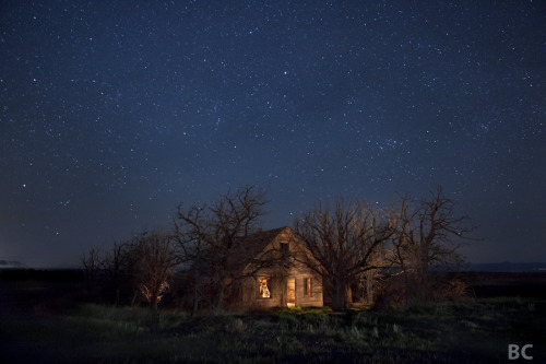 "From the Artist: ""While out exploring places far from city light pollution, I  occasionally come across houses, farms, structures that have long been  abandoned. It's fascinating to me the beauty these places can still hold while slowly falling to pieces. I get nostalgic and imaginative wondering who built it. What plans did they have, what lives did they live in these places? In its current state, it is a hazard. Many would call it a failure. A  body, dead, but unburied- bones and skeletons still standing. The  wallpaper is gone, the windows are usually broken long ago, roofs caved  in sometimes, stairs collapsed- but every one of those elements was once  purposefully and carefully put there, piece by piece until a house was  made"". Abandoned Homes Under the Stars by http://www.thestartrail.com/"