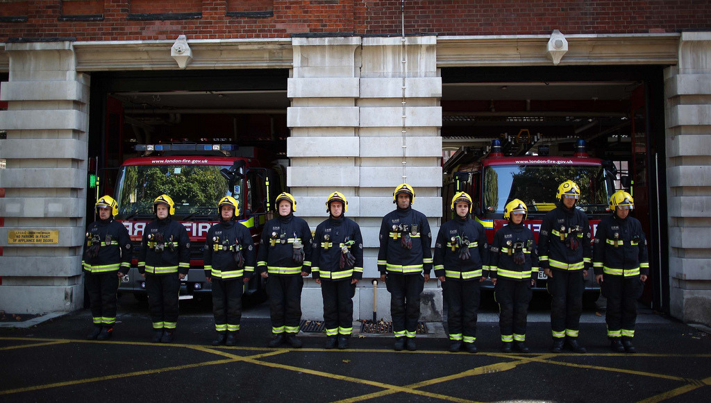 London Firefighters Observe a Moment of Silence on 9/11/11 by Trent Gilliss, senior editor Firefighters from the Clerkenwell Fire Station's Green Watch observe a moment of silence for their fellow firefighters who lost their lives in the 9/11 terrorist attacks in New York in London, England. (photo: Peter Macdiarmid/Getty Images)