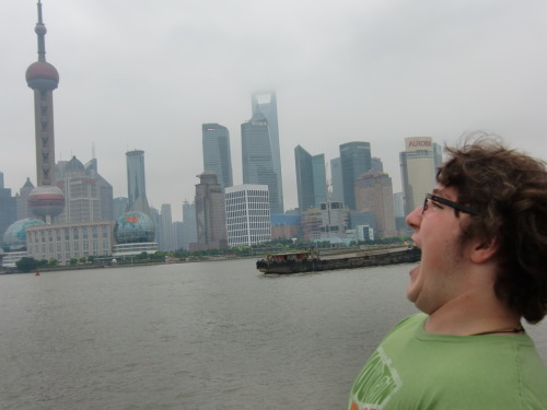 Evan eats a boat in Shanghai.
