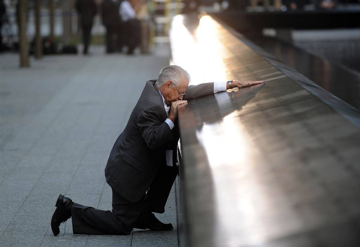 newshour:  Watch Live: 9/11 Ceremonies Mark a Decade Since Attacks breakingnews:  Robert Peraza, who lost his son Robert David Peraza in the attacks at  the World Trade Center, pauses at his son's name at the 9/11 Memorial.  (Photo by Justin Lane / Pool via AP)