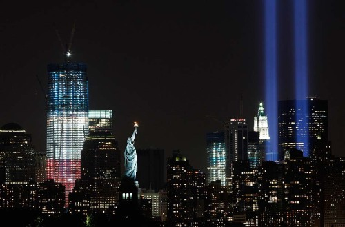 latimes:  The Tribute in Light shines above the Statue of Liberty and One World Trade Center, left, Saturday night in New York. View more Sept. 11 memorial photos on Framework. Photo credit: Mark Lennihan / Associated Press