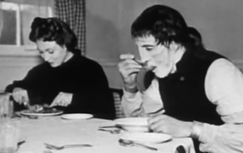 Hazel Court and Christopher Lee enjoy lunch in this behind the scenes shot from The Curse of Frankenstein (1957)