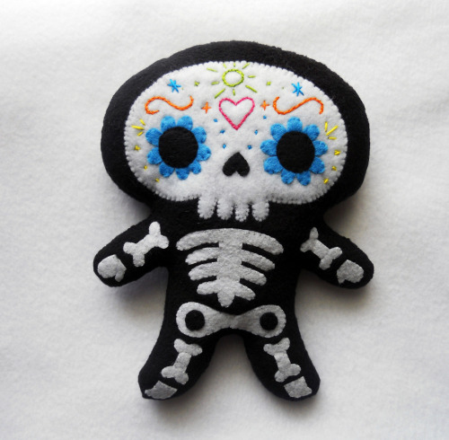 Sugar Skull Plush. By deadly_sweet on Flickr Photostream here. First found at craftzine here. Michele Legendre writes:  This plush is my piece for the 'Day of the Dead' show at Starkweather Arts Center in Romeo, MI on October 7th. He is 100% hand sewn with embroidery details on his face/skull.