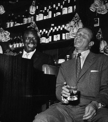 Frank Sinatra and Nat King Cole at the Villa Capri, 1955  (Photo by Bernie Abramson)