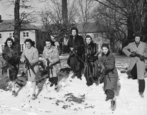 "kateoplis:  World War ll: Women at War | In Focus 1. These Northwestern University girls brave freezing weather to go through a Home Guard rifle drill on the campus in Evanston, Illinois on January 11, 1942.   2. Mrs. Paul Titus, 77-year-old air raid spotter of Bucks County, Pennsylvania, carries a gun as she patrols her beat, on December 20, 1941. Mrs. Titus signed-up the day after the Pearl Harbor attack. ""I can carry a gun any time they want me to,"" she declared.  There's something simultaneously terrifying and awe-inspiring about these pictures."
