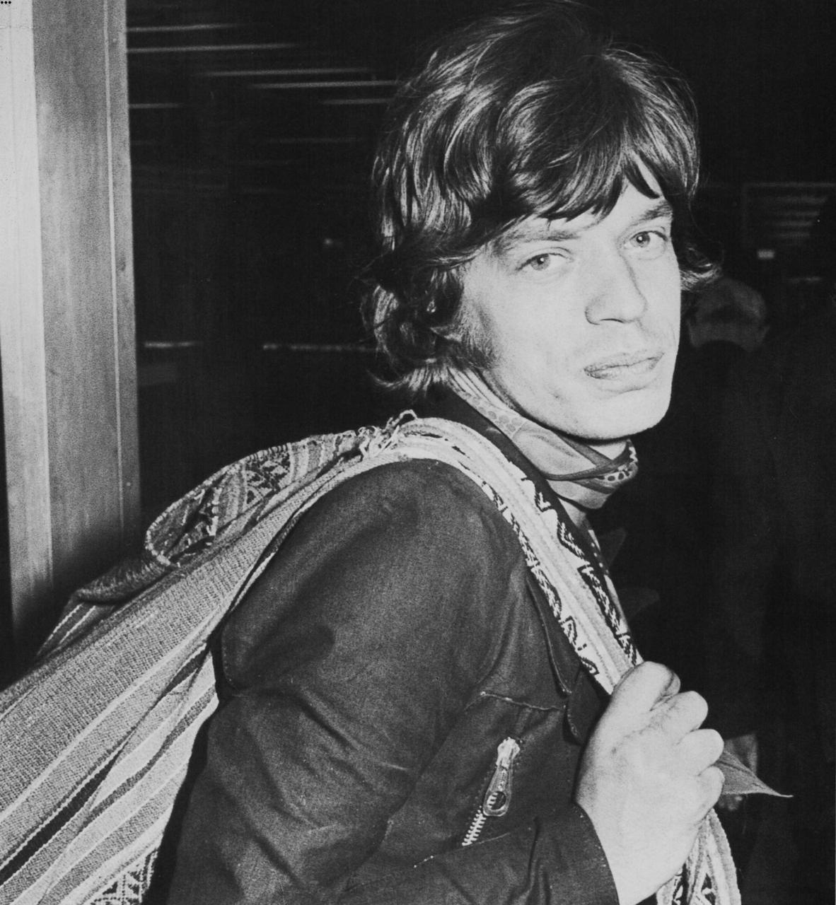 MICK JAGGER keeflepuff:  Mick en route to Los Angeles for recording, followed by the Stones' first American tour in three years, October 1969.