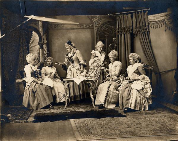 "Studio Tableau of Martha Washington's Tea Party, ca. 1890 Americans have long been fascinated by the country's colonial past. The historical foundations of the nation held a particular appeal in the late 19th and early 20th centuries, when many Americans viewed the rapid influx of immigrants from eastern and southern Europe as a threat to the American way of life.  Even in Wisconsin, where direct ties to Plymouth Rock and the Founding Fathers are tenuous, colonial revival sentiments inspired historic preservation efforts and influenced popular taste. In the 1890s in the Mississippi River town of Alma, photographer Gerhard Gessel portrayed his wife and her friends in his studio enacting ""Martha Washington's Tea Party,"" dressed to the hilt in 18th century-style fashions. via: Wisconsin Historical Images WHi-25934, Wisconsin Historical Society read more: Mary Miley Theobald, ""The Colonial Revival: The Past That Never Dies,"" Colonial Williamsburg Journal, Summer 2002"
