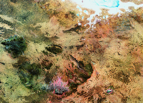 Ayers Rock and the Amadeus Basin (by europeanspaceagency) This Landsat 5 image, acquired on 18 May 2011, takes us to the Amadeus Basin in the heart of the Australian outback. Two large rock formations are visible on the lower section of the image. The group of 36 domed rock formations to the west (left) is the Kata Tjuta with the tallest dome, Mount Olga, reaching 1066 m above sea level. Forty kilometres east of Kata Tjuta is Ayers Rock, known to the Aboriginals as Uluru. The white area at the top of the image is the salt-crusted Lake Amadeus. ESA supports the Landsat series as a Third Party Mission, meaning it uses its ground infrastructure and expertise to acquire, process and distribute Landsat data to users. Credit: USGS.