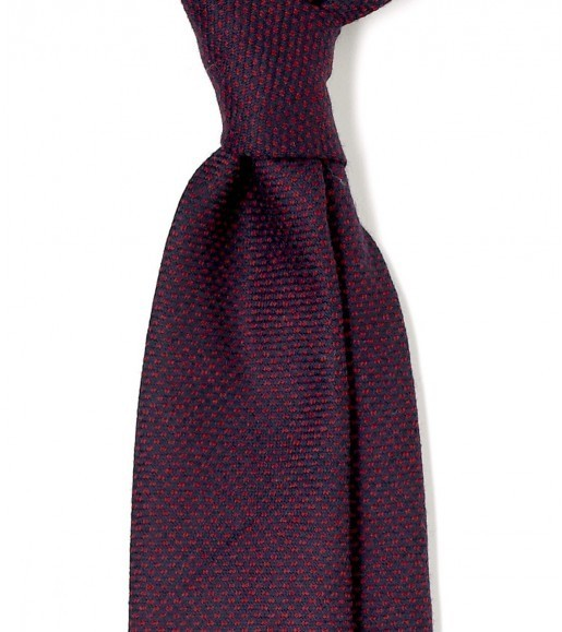 "putthison:  Ties for Fall The first photo above has haunted me ever since I first saw it at 13th and Wolf. It's what I would consider the perfect fall tie. The colors are warm, the pattern is simple but interesting, and the wool fabric gives the tie a nice, soft appearance. Together, these characteristics make it the perfect expression of fall.  While we may never own a tie so ideal, there are some great ties to take advantage of this season. Here are seven types that you should consider: Most of your seasonal ties for fall should be made (at least in part) out wool. These can come in many forms - wool challis, wool flannel, tweed, etc. Challis is a plain weave that feels supple and lightweight; flannel will have a soft, brushed nap; and tweed will be a bit rougher. Like with silk ties, a solid color can work well if the fabric has a bit of texture to it (eg brushed flannel). For something slightly more interesting, you can also get a plain colored tie, but one with a slightly mottled weave or herringbone pattern. My favorites, however, are wool ties with small geometric patterns, stripes, or checks such as windowpanes. A number of tweed ties also come speckled, which can be interesting.  Like wool ties, cashmere ties also make for excellent fall staples. Since the material is more luxurious, they will typically cost a bit more than wool, however. Since they're softer, they also don't typically wear as well. Another traditional fall tie is the ancient madder. Ancient madder ties are distinguished by their muted hues, traditional patterns (often with paisleys) and their soft, matte finish. You'll find beautifully deep, soft, matte colorings, such as mustard yellow, jade green, and indigo blue. They're produced on a special ""gum"" silk, and when handled, they have a hefty, chalky hand similar to fine suede. They can come in paisley or any number of small, geometric designs. I had a phase once where I went a little tartan crazy. Now I find that with the exception of black watch, it's hard to wear tartan ties. However, one thing they go excellently with is a tweed jacket. It makes sense given how popular the two are in Scotland. If you own a tweed jacket, I don't recommend you go out and buy ten tartan ties like I did, but maybe buy one.  Your regular run of woven silk ties can still feel seasonal. Just keep your colors autumnal - burgundy, chocolate, hunter green, and pale gold are all good colors to stand by.  So where to buy some of these ties? My favorite shops are Drake's (pictured above), Sam Hober, Paul Stuart, Ralph Lauren, and J Press. Additionally, some excellent options are available at Howard Yount, Mountain and Sackett, and Ovadia and Sons. For those looking for something more affordable, Land's End also has a couple of handsome wools for between $50 and $60. Finally, note that seasonal ties aren't a necessity. You can still obviously wear your regular rotation of silk ties - grenadines and knits are still great ties to wear regardless of the season. It's just that having a seasonal touch here and there can be fun, and the above are good options to consider."
