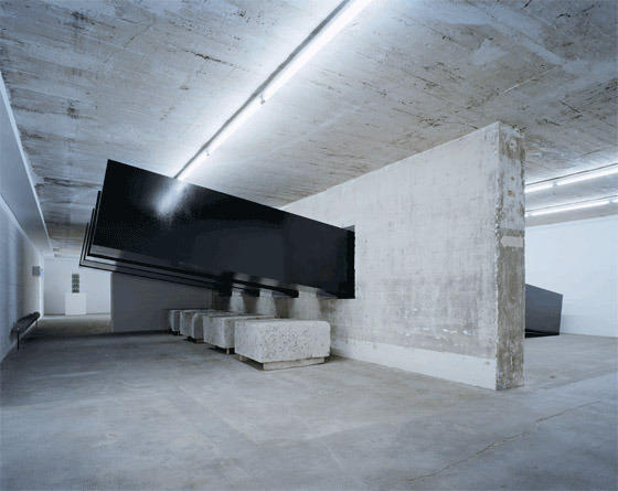 contemporary-art-blog:  Santiago Sierra artist from Spain, Construction and installation of four tar-coated forms, Boros Collection in Berlin, 2002Follow: Contemporary-Art-Blog
