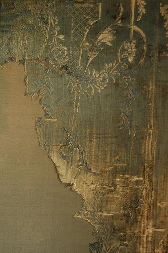 distressed silk wall panels at Warwick Castle.