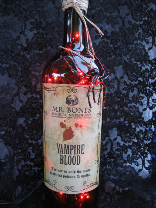 365daysofhalloween:  Halloween Vampire Decorative Upcycled Lighted Wine Bottle with Black Widow Beaded Spider Charm by fuzzyelephant on etsy