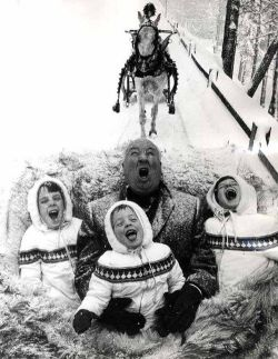 Alfred Hitchcock and his kids having a good time.