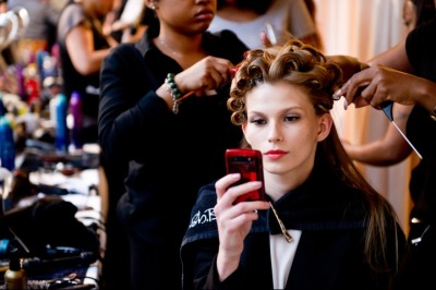 vogue:  BACKSTAGE: Zac Posen Spring 2012  lol @ photos of models checking their phones or reading a book while getting their hair done. a perennial fashion week favourite.