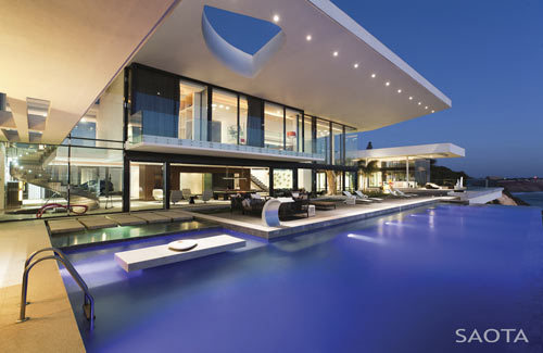 "not an umbrella. klg19:  This insanely luxurious house in Dakar (Senegal) has an infinity pool on a cliff overlooking the Atlantic (I like the weird cutout in the roof of the overhang) and a wonderful spiral staircase:  Much of the rest of the house is quite…stark, however:  As one commenter notes, ""It would be like living in a hotel lobby."" The pool area is definitely the highlight!  See more here."