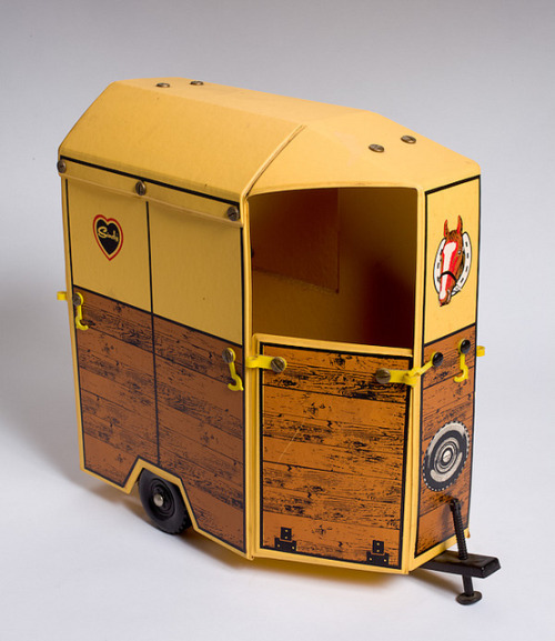 A toy trailer horse box for the Sindy horse, 1989_126  by Black Country Museums on Flickr.Via Flickr: The trailer has a yellow body and features a back door which, when open, forms a ramp into the trailer. There is room inside for two Sindy horses.