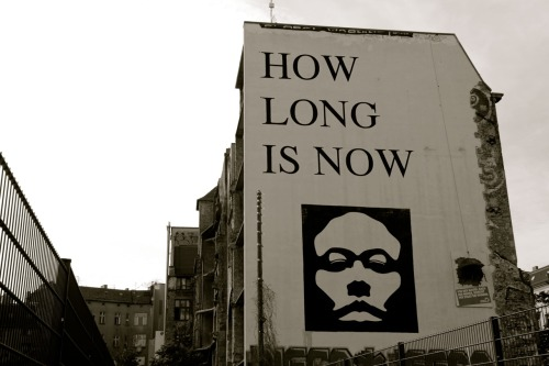 sometimesatourist:  how long is now?  mural by Yz, at Berlin's Techeles urban art gallery. Read more here.