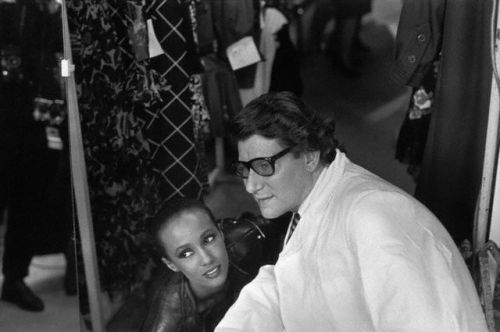 Iman and Yves Saint Laurent in Paris, 1982. Photo by Peter Turnley.